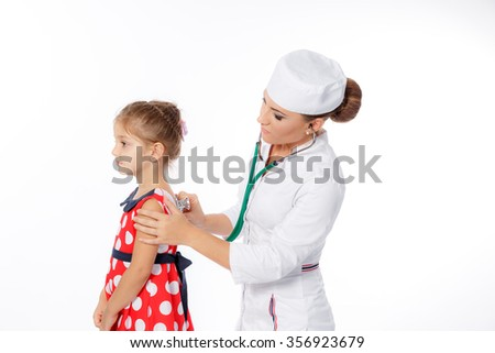 Pediatrician doctor examining little girl. - stock photo