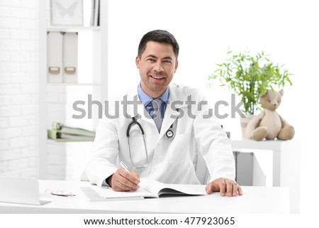 Pediatrician doctor in office