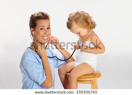 Pediatrician examining a baby girl  3 - stock photo