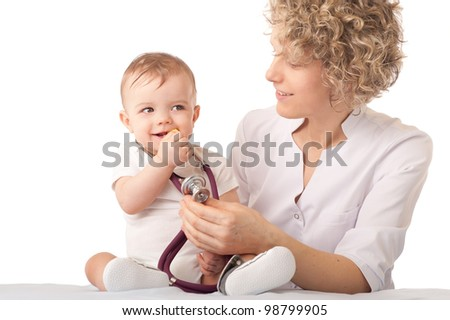Pediatrician examining baby with stethoscope. - stock photo