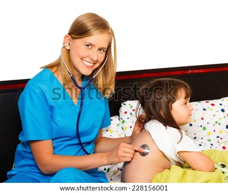 Pediatrician examining with stethoscope her little patient. - stock photo