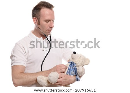 Pediatrician listening to a teddy bears heart using his stethoscope demonstrating to a young patient that there is nothing to fear, isolated on white - stock photo
