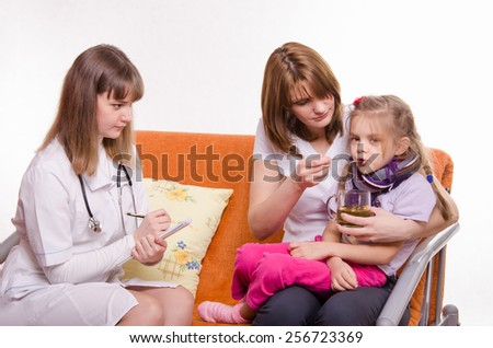 Pediatrician prescribes treatment child whose mother gives to drink tea from a spoon