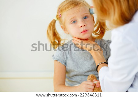 Pediatrician taking temperature with professional thermometer. - stock photo