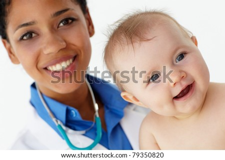Pediatrician with baby - stock photo