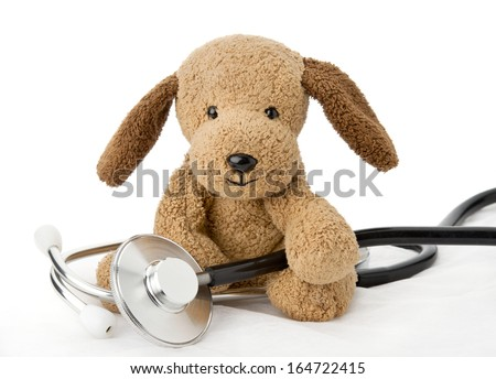 Pediatrics. Puppy toy with medical equipment - stock photo
