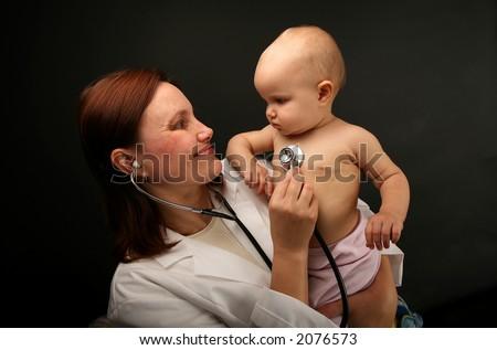 pediatrist - pediatrician -physical exam by Doctor - stock photo