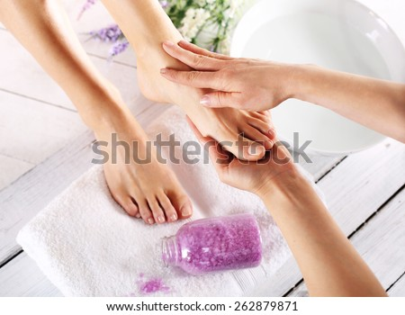 Pedicure and foot massage.Woman in a beauty salon for pedicure and foot massage. - stock photo