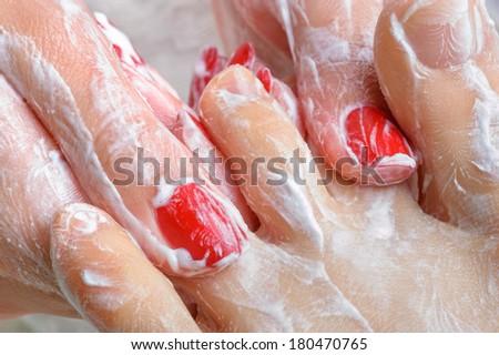 pedicure. feet massage with moisturizing or peeling cream. - stock photo
