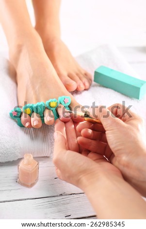 Pedicure. Foot care treatment and nail, the woman at the beautician for pedicure. - stock photo