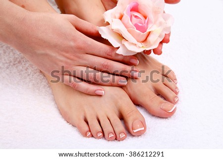 pedicure on legs and beautiful manicure on hands closeup - stock photo