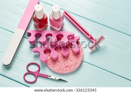 Pedicure set on wooden background - stock photo