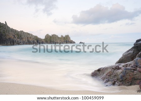 Pedn vounder beach, one of Cornwall's best beaches with stunning cliffs of Treryn Dinas, crystal clear water and a beautiful sandy beach. - stock photo