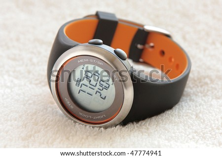 Pedometer sport watch on an white towel - stock photo