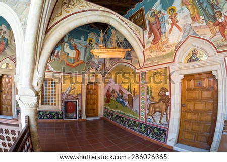 PEDOULAS, CYPRUS - APRIL 29: Fisheye view on ancient Kykkos Monastery (1081) passage ornate by icons on April 29, 2015 in Pedoulas.  - stock photo