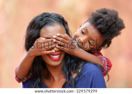 Peekaboo Mother and Child Playing Outdoors - stock photo