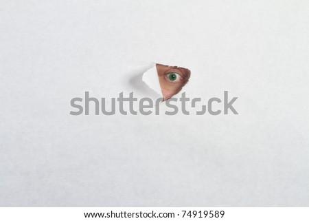 Peeking through a hole - stock photo