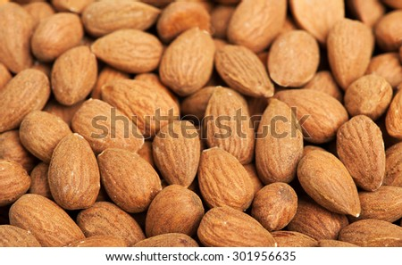Peeled almonds closeup - stock photo