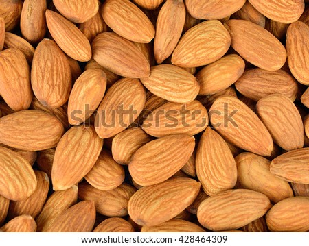 Peeled almonds closeup. - stock photo