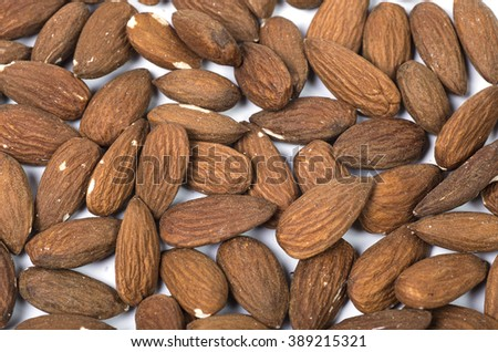 peeled almonds, closeup on white background