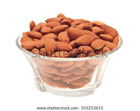 Peeled almonds in a glass bowl. Isolated on white. - stock photo