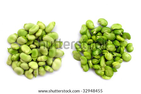Peeled and unpeeled fresh broad beans - stock photo