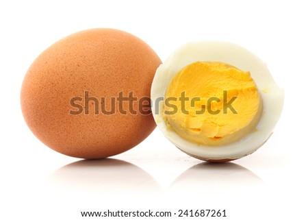 Peeled boiled egg on white background - stock photo