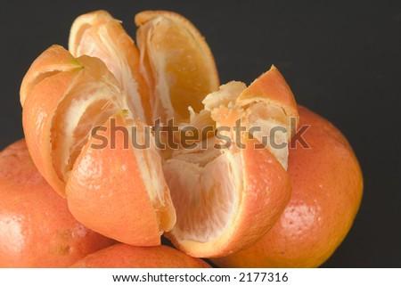 Peeled fresh tangerine fruit - stock photo