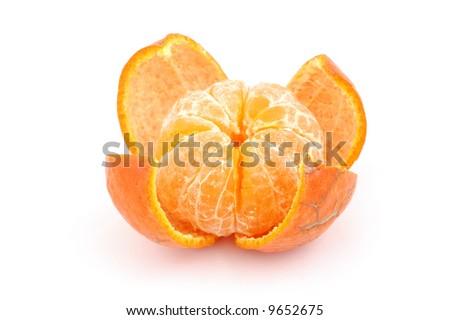 Peeled fresh tangerine in isolated white background - stock photo