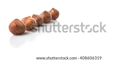 Peeled hazelnut nut over white background