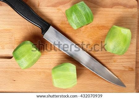 Peeled kiwifruit (kiwi). Directly Above. - stock photo