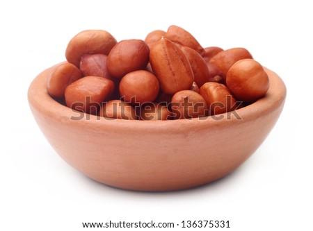 Peeled peanuts on a clay pot - stock photo
