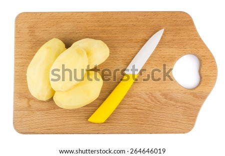 Peeled raw potatoes and ceramic knife on hardboard. Top view. Isolated - stock photo