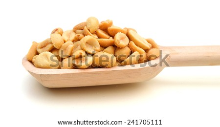 Peeled salted peanuts isolated and wooden spoon on white background  - stock photo