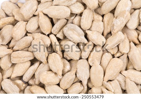 Peeled sunflower seeds. Close up. Texture as background