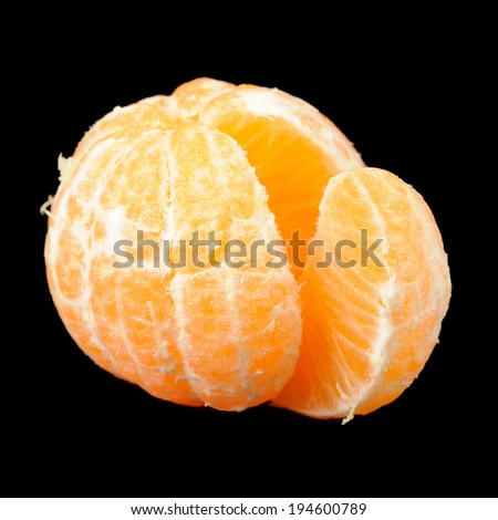 Peeled Tangerine on Black Background - stock photo