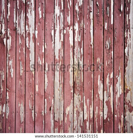 Peeling brown paint on weathered wood texture - stock photo
