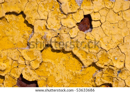 Peeling cracked yellow rusty paint macro background - stock photo