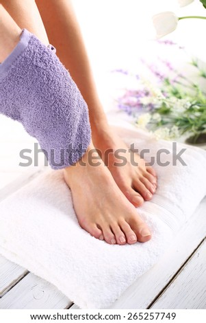 Peeling feet massage sponge.Foot care treatment and nail, the woman at the beautician for pedicure. - stock photo