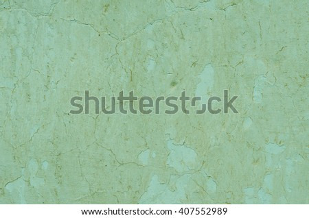 Peeling green plaster on the wall. textural composition - stock photo