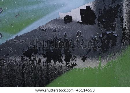 Peeling paint on an old surface - stock photo