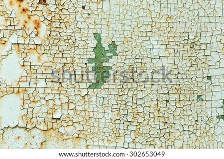 Peeling paint on wall. Texture of green grunge material. Grunge background. - stock photo