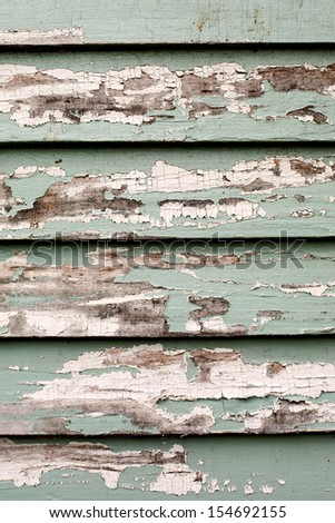 peeling paint on wood boards - stock photo