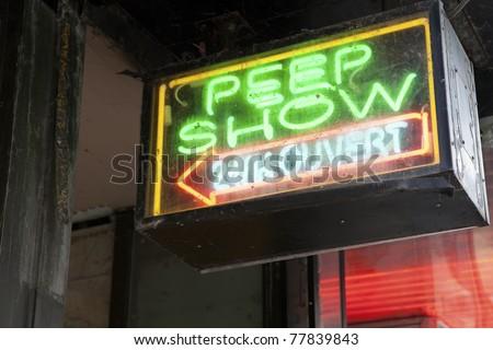 Peep Show neon signage - stock photo