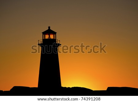 Peggys Cove Lighthouse Silhouetted in Sunset