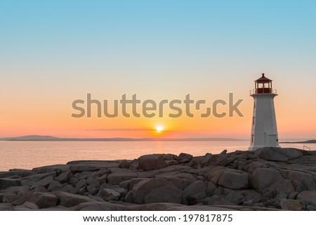 Peggys Cove's Lighthouse at Sunset (Nova Scotia, Canada) - stock photo