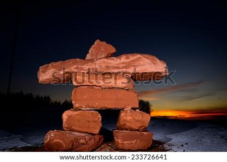 PEI Sandstone Inukshuk at sunset - stock photo