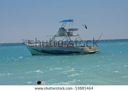 Pelican flying over yacht boat - stock photo