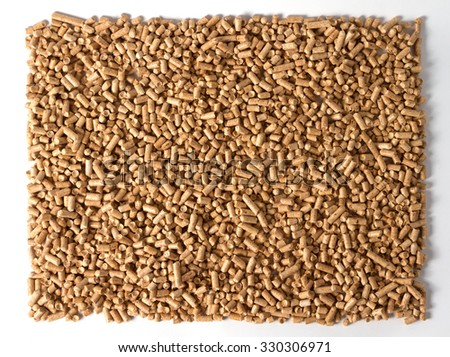 Pellets - the new eco-friendly fuel, made from pine wood shavings. Pellets are more environmentally friendly than coal. Pellets emit only half as much heat Nathon than natural gas per cubic meter. - stock photo