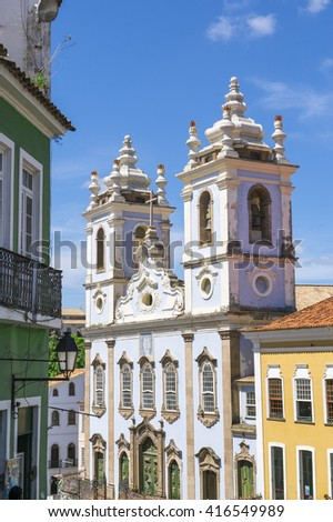 Pelourinho Salvador da Bahia Brazil historic colonial church architecture of the Church of Our Lady of the Rosary of the Blacks under bright blue skies - stock photo